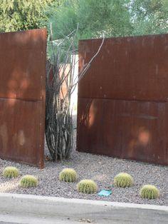steel fence - backyard & short wood fence of same color in front?