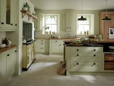 Sage cabinetry with cream rangemaster oven.
