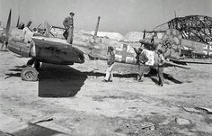 American soldiers inspect captured German Henschel Hs 129B of 5.(Pz)/Schlachtgeschwader 1 at El Aouiana airport, Tunis, Tunisia, in May 1943. (United States Library of Congress Photograph.)