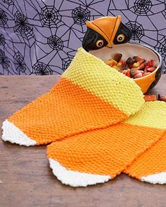 Free Knit Pattern: Sugar'n Cream - Candy Corn Dishcloth. A quick, easy Halloween favor for the spookiest of Halloween kitchens!