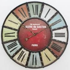 Colourful antique style informs the nostalgic aesthetic of the Galarie du Gaston wall clock, with thick roman numerals and bold iron struts creating a distinctive piece of wall decor. Kare Design, Gaston, Roman Numerals, Wall Colors, Designer, Robin, Retro Vintage, Wall Decor, Paris