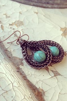 Oxidized copper viking knit earrings with turquoise focal bead on Etsy, $28.00