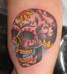 Old school and Mexican style skull tattoo