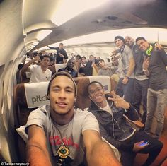 Relaxed: Neymar (pictured front left on a flight with his teammates) is widely considered to be Brazil's best hope of winning the World Cup on home soil. 2014