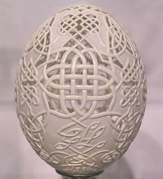 carved celtic knots on an egg. so pretty