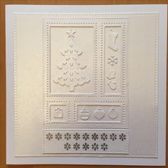 This Christmas card was made using Sue Wilson's Shadow Box Christmas Die set.  The snowflake font was cut from vinyl using a Silhouette Cameo.
