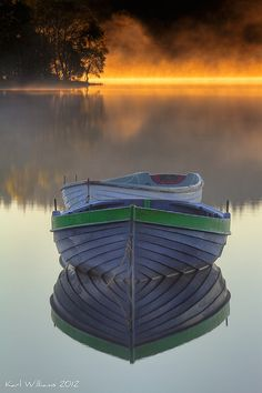 Loch Rusky, Scotland.. Love the way the reflection looks and the fog coming off the water. Beautiful