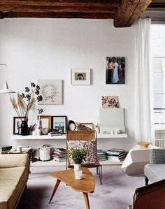 What's our new favorite design trend? The single shelf, floating a few inches above the floor, has the effect of a console, but with an added visual lightness. Above, you can prop (or hang) paintings and objets. Below, you can stack books (or shoes, or what have you), so you're getting added storage, too.