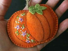 orange wool felt pumpkin with hand embroidered purple flowers orange wool felt pumpkin with hand embroidered purple flowers Autumn Crafts, Thanksgiving Crafts, Holiday Crafts, Fall Felt Crafts, Felt Embroidery, Felt Applique, Felt Flowers, Purple Flowers, Exotic Flowers