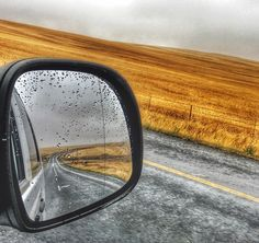 Photo by @manablazemick • side mirror shot · rear view · looking back · mountains · road trip · travel · black and white · South Africa · sunset · rural · photography · traffic · transport · landscapes