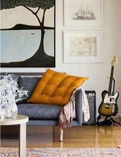 http://10rooms.blogspot.de 'Inspiration' Pale flooring matched with gray sofa.