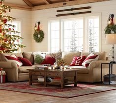 great cozy room design - love the skis over the window with the wreaths... Love Sweater Pillow Cover | Pottery Barn