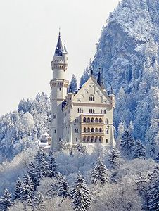 a castle in snowy mountains in Bavaria