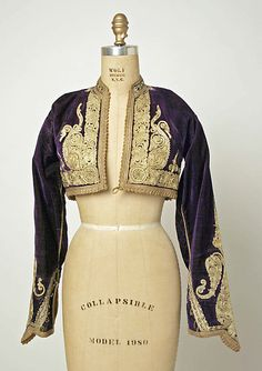 Bolero Jacket: A short jacket, coming barely to the waist; worn by men in Spain; applied to a similar garment worn by women elsewhere, usually over a blouse or bodice.