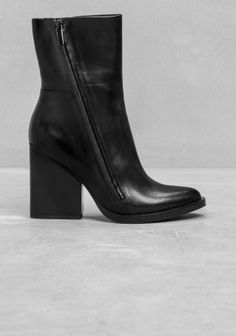 An ankle leather boot featuring a soft almond toe, a stacked leather welt and a chic leather-covered heel.