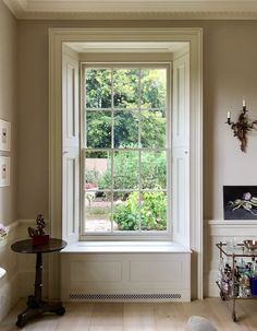 Interior handsome discreet shutter. Classic Homes Adam Architecture Bighton Grange -George Saumarez Smith drawing room window detail garden