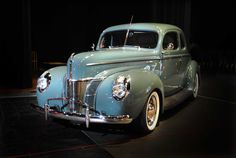 2013 Grand Marshal Awards: Pictured is a 1940 Ford Deluxe Coupe in Green. Owners, Tim and Linda have been working diligently at home to complete the Ford Deluxe Coupe over the last seven years. They're staying cool during HAN with a rare feature in a classic car- A/C!   Vote on your favorite car! Check us out on Facebook at The Drive with Alan Taylor.