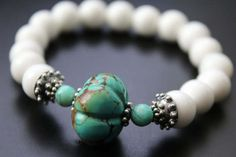 Carved turquoise melon bead and white shell by mayababyjewelry