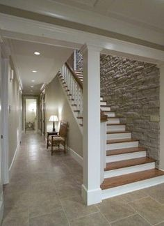 Love the stone wall down the basement stairs by lorie