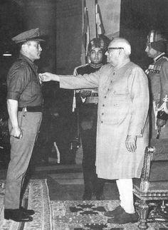 Receiving his MVC from V. V. Giri