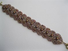 Amethyst and gold Persian Lullaby hand beaded by BeadALittleDream