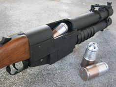 The M79 and XM148 grenade launchers were single-shot, and the repeating T148E1 grenade launcher was unreliable, so a request was made to China Lake engineers. SEAL Teams were pleased with the resultant pump-action grenade launcher, since the tubular magazine held three 40x46mm grenades, and so with one grenade in the chamber, four grenades could be fired rapidly before reloading. In fact, a skilled operator could fire four aimed shots before the first one landed. Weapons Guns, Guns And Ammo, Rifles, Revolver, Fire Powers, Cool Guns, Firearms, Shotguns, Self Defense