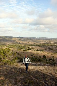 TLC volunteer hiking at Brushy Top. Enjoying views from the elevation in the Texas Hill Country.