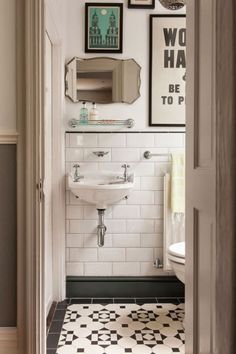 Lovely design for a smaller bathroom/toilet. The photos and posters really give it classy feel.