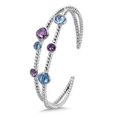 Sterling Silver Amethyst & Blue Topaz Cuff - A Fashionable Sterling Silver Amethyst & Blue Topaz Cuff with a playful rope texture and open design with alternating round a cushion stone shapes.