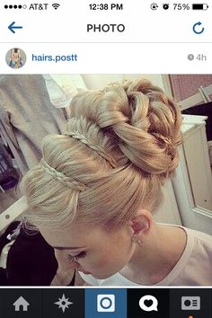 Braids across the top of the head with it up on top.
