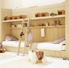 non-bunk bunk beds-- I dig this. Maybe an idea for S's big girl bedroom. Storage above her bed accessible by a ladder-- maybe a shelf strong enough to accomodate a little pallet for her to lie or sit on someday (when she's old enough that it's safe).