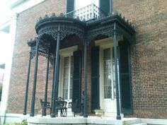 Sally Polk fell in love with the New Orleans iron work and convinced her husband George to import it to use on this entrance. Beautiful, isn't it? Photo by Betty Bolte