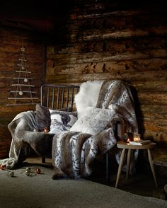 Transform your home with cosy throws and cushions this Christmas from John Lewis