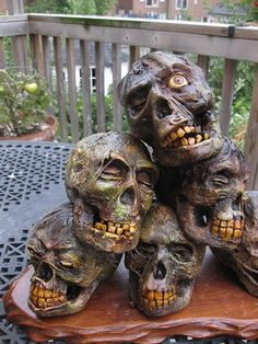 Making Corpsed Heads from Styro Skulls - Part 2 - HauntForum shows how to reshape skull and also make teeth from sculpey clay
