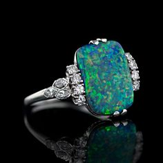 Ring | Designer ?.  Platinum, black opal, diamonds.  c. 1950s.