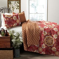 Outfit your guest room or master suite in eye-catching style with this bold cotton quilt set, featuring a paisley-inspired floral motif.