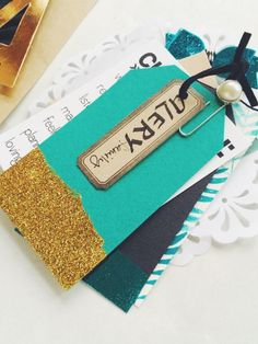 Metallic Accents - ClearSnap Blog Classic and trendy, this teal + gold + black mini album was created with scraps on Sabrina Alery's desk. Make gift tags inspired by this look to hang on your holiday gifts. Sabrina uses our Design Adhesives transfer sheets to add glitter, embossing powder, and foils. Details here: http://blog.clearsnap.com/2015/11/metallic-accents/