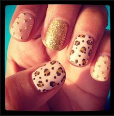 ooooh leaopard and gold #nailart #nailpolish :-) me likey!  {Hey, have you downloaded the FREE Sweater-izer App yet?  It's awesome fun if you like a tacky Christmas sweater!  Check it out: http://funistheanswer.com/sweater-izer/