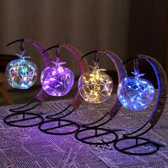 Looking for a night light for the apple of your eye? These fairy light lanterns on a crescent moon stand filled with colorful LED string lights add artful ambiance to a bookshelf, table or nightstand. Quince Decorations, Light Decorations, Outdoor Decorations, Led Decorative Lights, Copper Wire Lights, Moon Fairy, Globe Pendant Light, Pendant Lights, Apollo Box