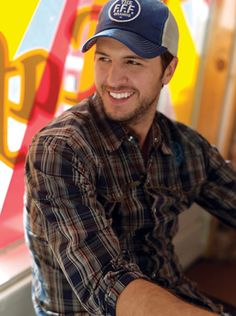 I don't think he's cute all the time but those teeth! Plus the stubble and cap, and tight jeans, and frequent v-necks, and accent...okay, I guess I'm a fan.