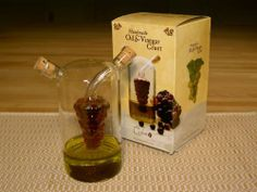 Olive Oil and Vinegar Cruet Grape Bunch Design by Ceylon Teas. $9.99. The Oil & Vinegar cruet is cleverly designed to contain oil and vinegar in separate chambers.. The Oil & Vinegar cruet is cleverly designed to contain oil and vinegar in separate chambers. Separate spouts control the flow to create your ideal mix. The hand-blown glass design and contrast of the ingredients makes an elegant statement to any gourmet kitchen.. Save 67%!