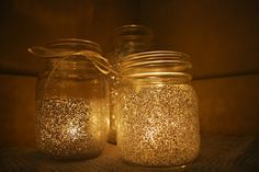 Glittery mason jars with electric candle inside.