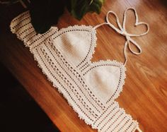 This crochet top is handmade and comes with tassels at the bottom. The baby pink color makes this spring top a great addition to any boho wardrobe. This halter top comes with adjustable tied around the back and neck. Sizing:  One size fits most Adjustable Ties Around the Back and Neck