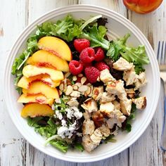 This Peach & Raspberry Chicken Salad is a simple Summer salad with a lot of flavor! With homemade Peach Vinaigrette.