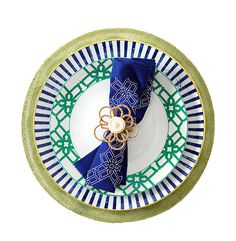 """Twine Flower"" napkin ring and ""Tuileries"" placemat, Juliska; ""Truman"" dinner plate and napkin, B By Brandie; ""Transatlantica"" charger by Vista Alegre. - Photo: Peter Krumhardt"