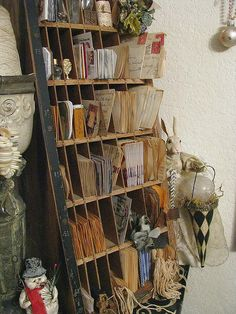 enchanting. I have similar slotted shelves I picked up thrown out behind a store. Great for paper etc.