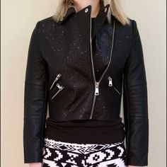 """HP 1/324HRS Sparkle Magic Moto Jacket This jacket is NWT! It is faux leather with an all over black glitter body. There is matte black faux leather on the back panel and the sleeves. There are zippers on the open front, ends of sleeves, and three front pockets. The glitter does come off. It is approximately 15"""" across the bust when laid flat and zipped. It is approximately 17"""" from shoulder to hem. The sleeves are approximately 22"""" long. Self:  100% polyurethane  Contrast:  100% polyurethane…"""