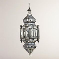 "Our Extra Large Domed Lantern is certain to exude your well-rounded sense of style. Handcrafted in India with a traditional Moroccan shape and carved metal accents, this beautifully oversized lantern is perfect for casual or formal décor. It holds one 3"" diameter pillar candle, and dances to life when lit., #464985, 129.00, 2015"
