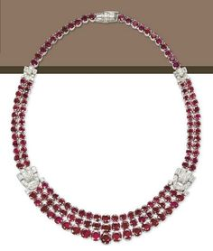 A RUBY AND DIAMOND NECKLACE, BY GAZDAR.   The front section designed as three rows of graduated oval-shaped and circular-cut rubies with pavé-set and baguette-cut diamond geometrical clasps, to the two rows of similarly-set rubies and one row neckline, circa 1965, 38.0 cm  Signed Gazdar