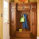 This oak entryway ensemble finished in Autumn Blush gives guests a warm welcome and a place to hang their coats.